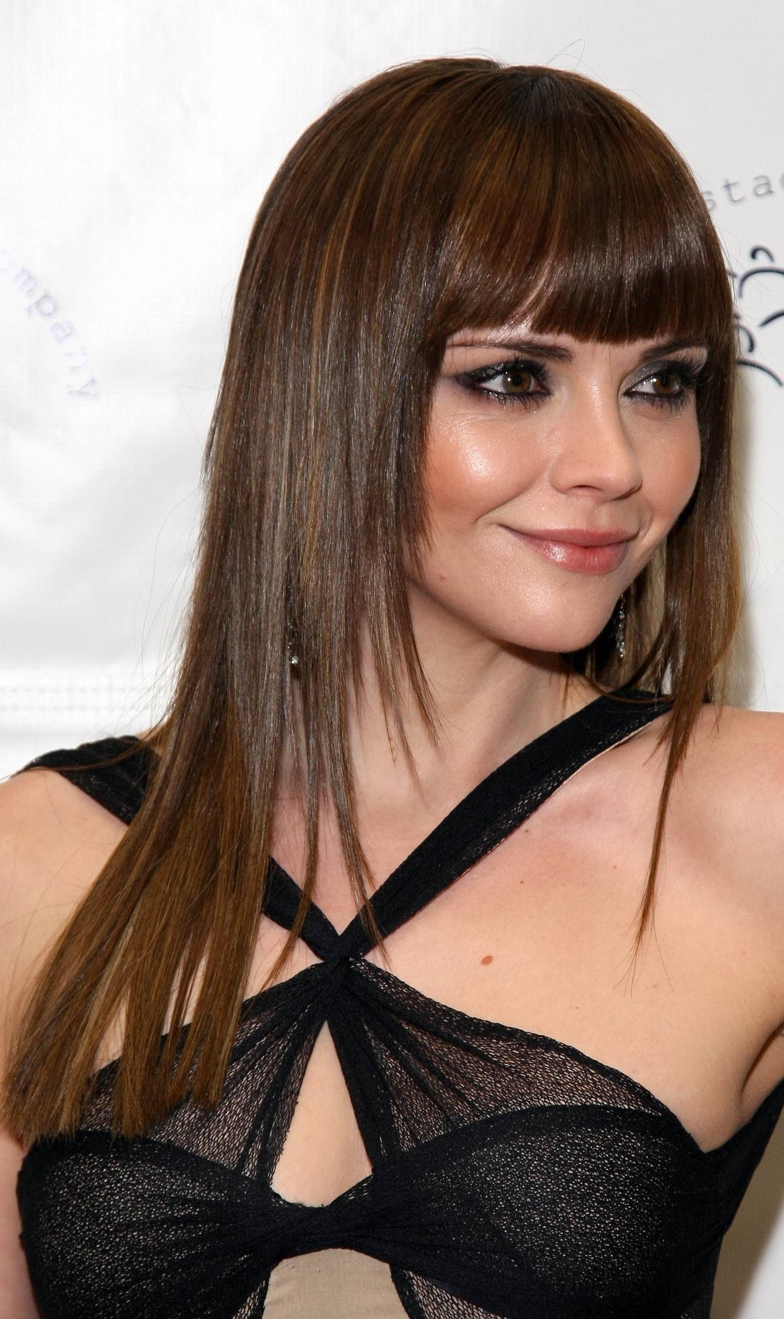 Hairstyles with Long Rounded Straight Bangs