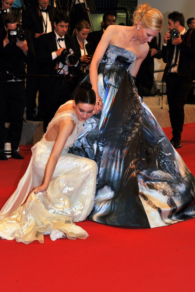 Cate Blanchett and Rooney Mara, adjusting their dresses in a perfectly synchronized movement Cannes Film Festival May 2015