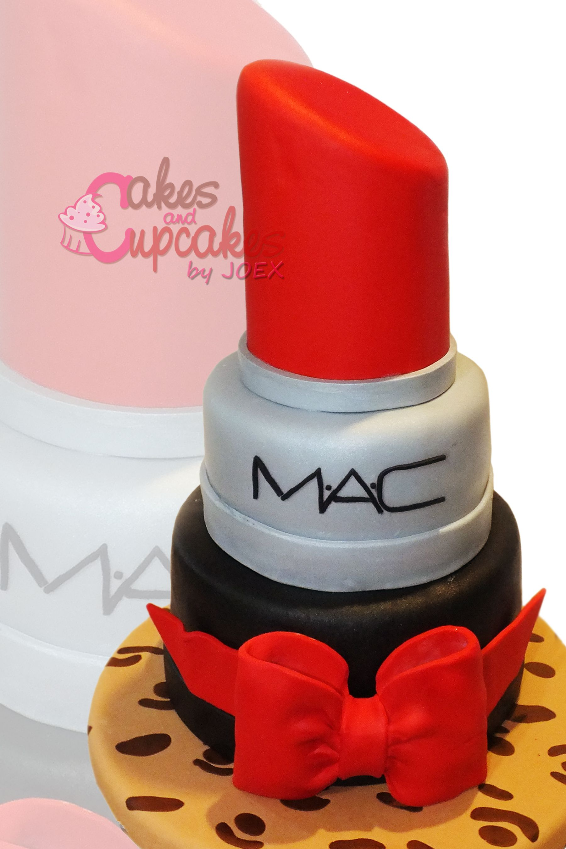 Three tiers MAC Cake with hardened fondant bow Airbrushed