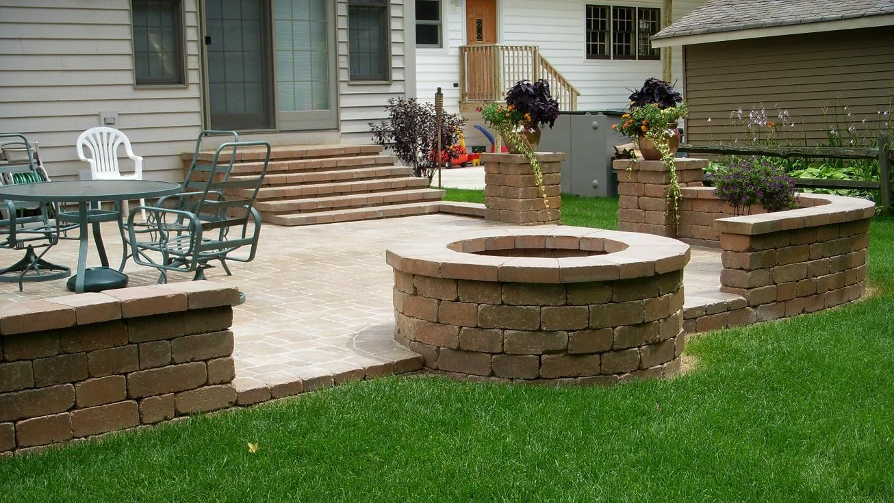 Backyard patio pavers unilock paver patio firepit for Patio ideas with fire pit on a budget