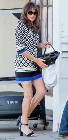 Caitlyn Jenner steps out in mini dress (photos)