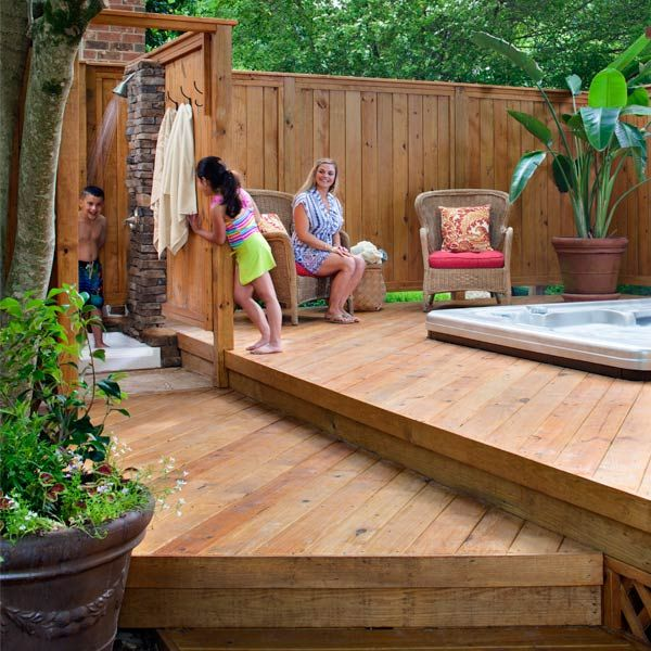 Photo of Wood Deck Around Hot Tub with Privacy Fence