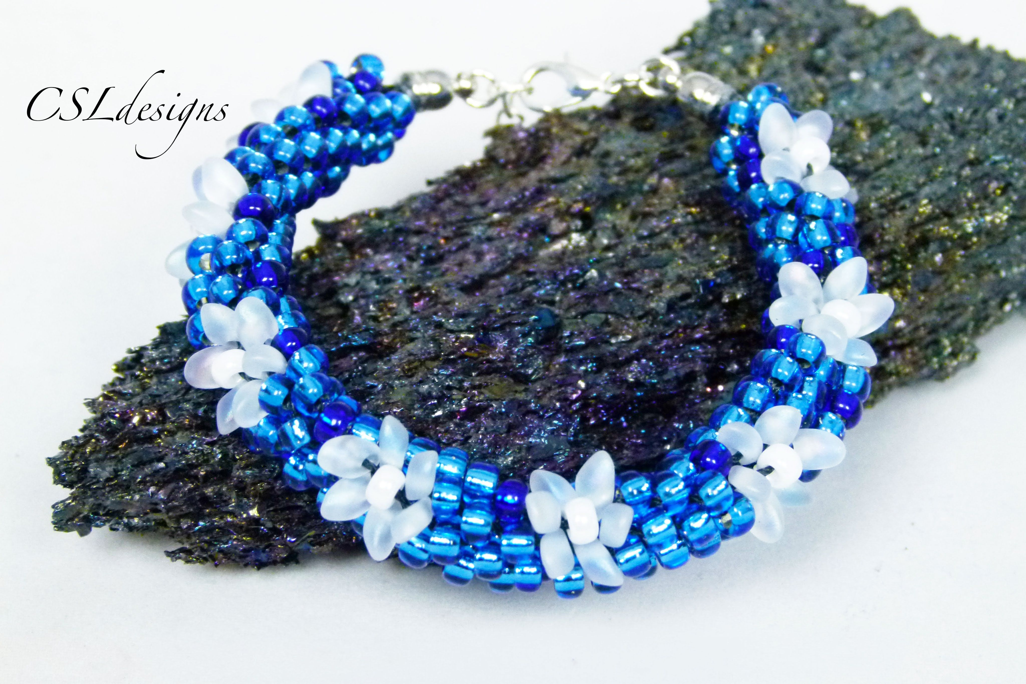 In this tutorial I show you how to make a frozen inspired beaded kumihimo bracelet. Please feel free to give it a go yourself and I hope you enjoy. Round kum...