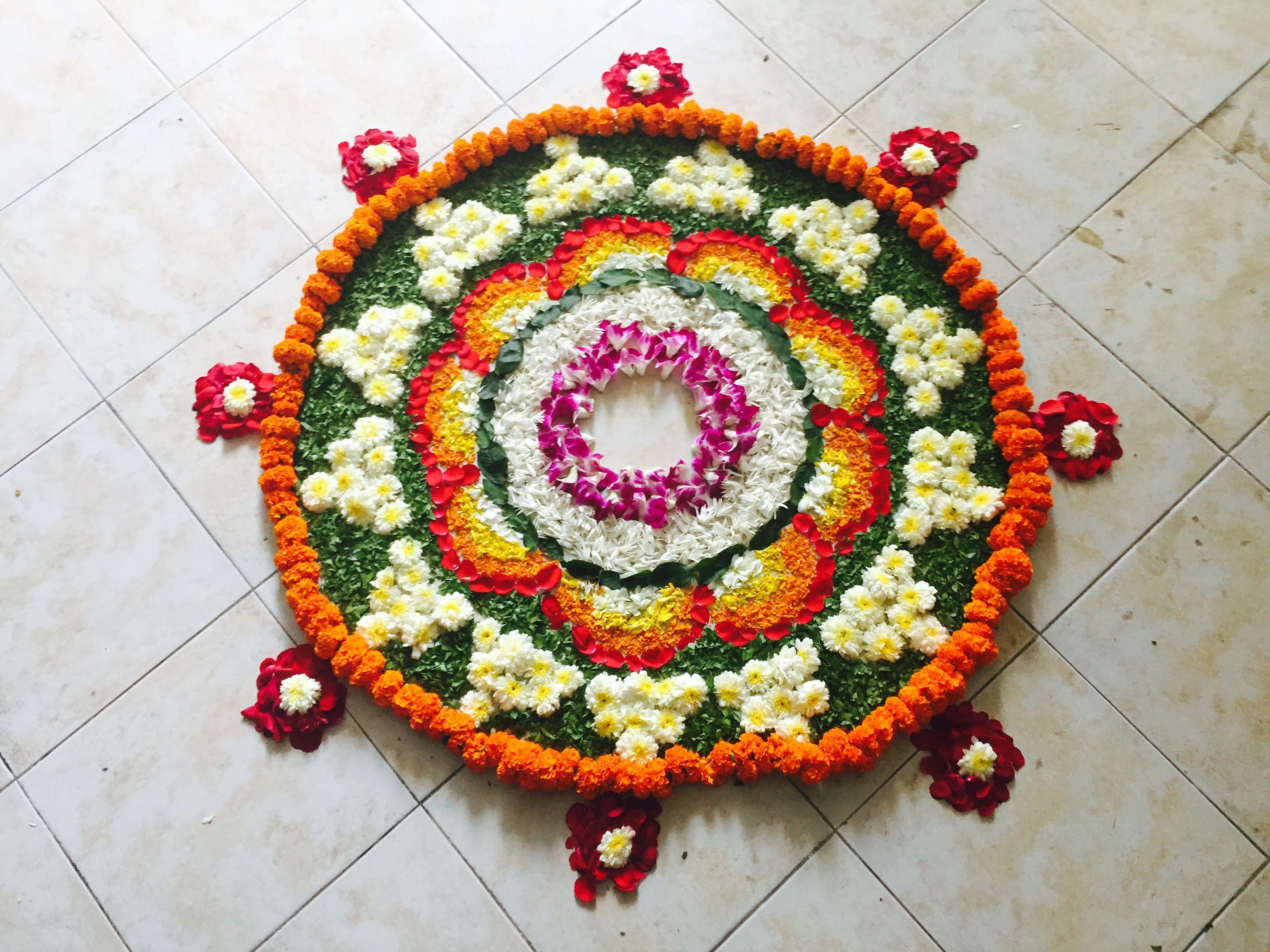 Diy House Housewarming Flower Rangoli Floor Decoration Using Flower Petals Leaves In Centre Place A Flower Rangoli Flower Decorations Rangoli Ideas