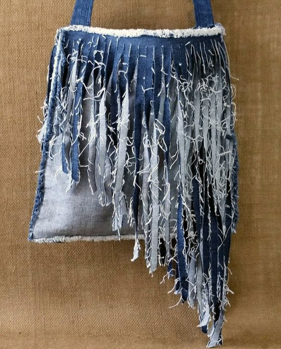 Well I did it again, another favorite! (Well, anything with fringe is my favorite, who am I kidding!!! I used recycled denim to make this angled long fringe cross body purse. All designs are 100% handmade by Miss Thread.Thank you so much for browsing my shop and supporting my love of recycling! - Michele