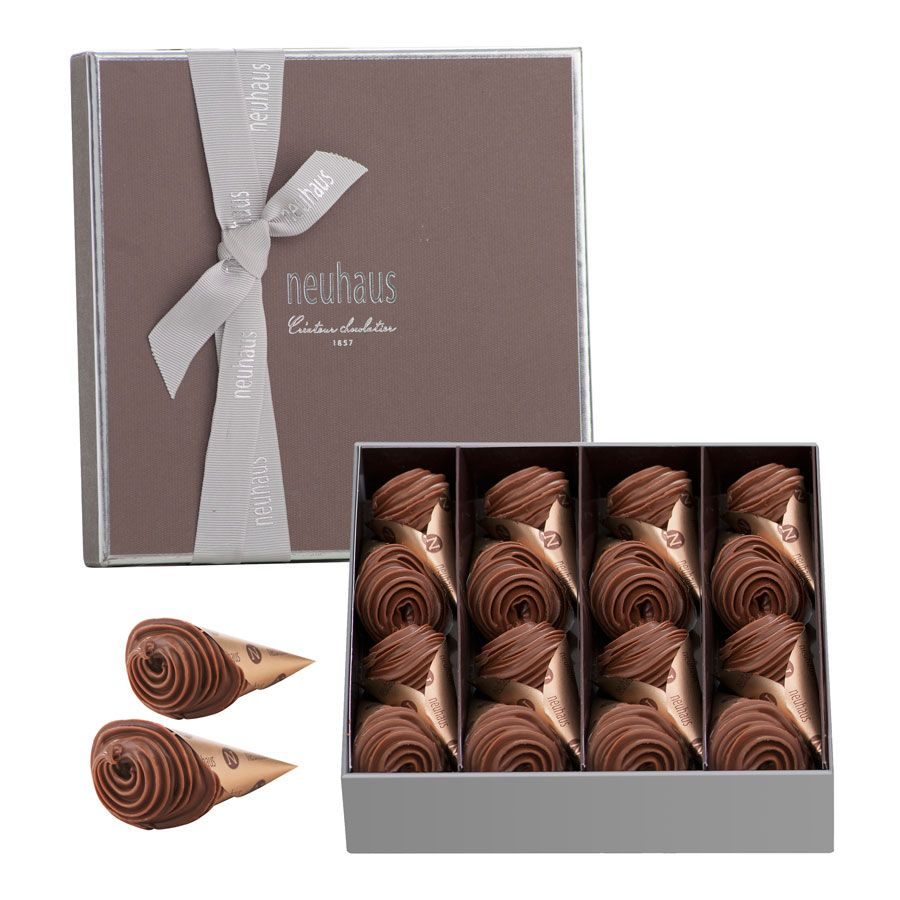 Luxury Belgian chocolate, gianduja piped into a golden cone. Send ...