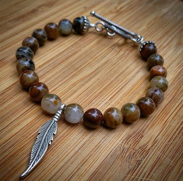 Bring the earth tones to life everyday with this Brown Opal, Bali Silver Feather and Toogle.   Shacklesco.com
