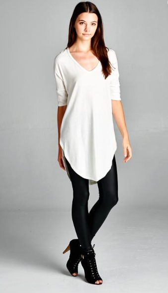 ddc434a6235 Loose fit, three-quarter length dolman sleeve, scoop v-neck tunic top. Has…