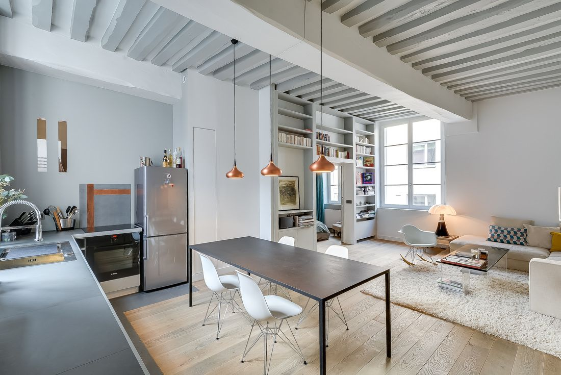 Garçonnière Marais is a minimalist house located in Paris, France, designed by Tatiana Nicol. The 50 sqm apartment features exposed ceiling beams and a custom partition with built in storage and shelving space. (1)