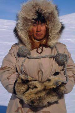 Portrait of Inupiat Eskimo man in Wolf ruff Parka Buckland Alaska Western Spring
