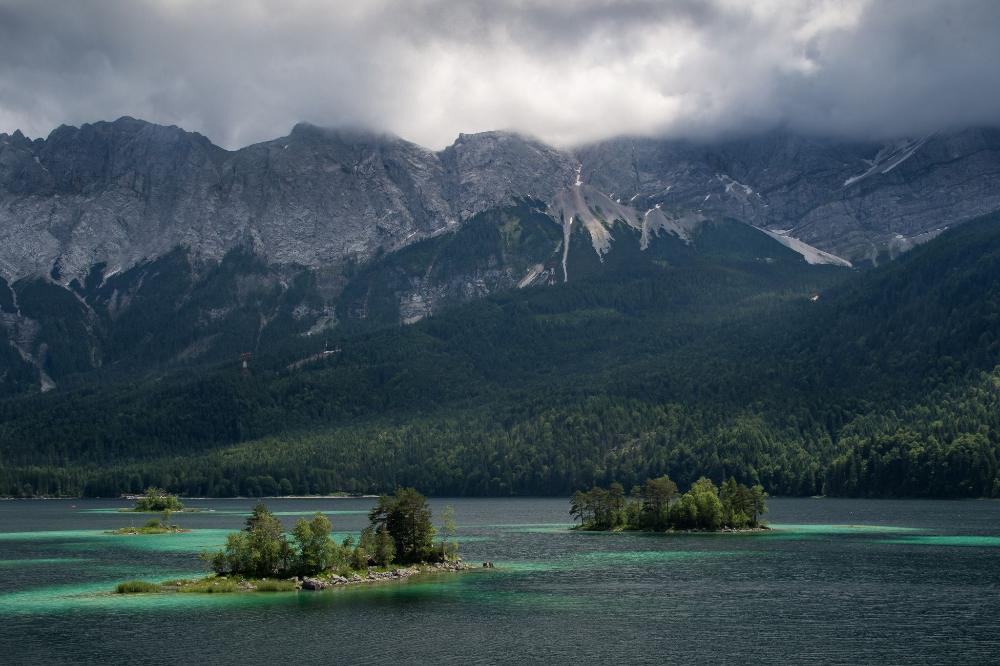 Eibsee with the Zugspitze Germany's highest mountain covered in clouds [OC][2048x1365] http://ift.tt/28VfsZe