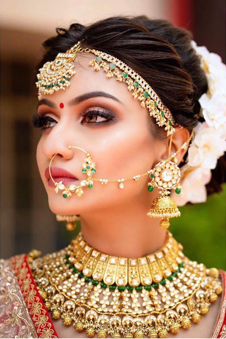 Indian Bride In Traditional Gold Wedding Jewellery
