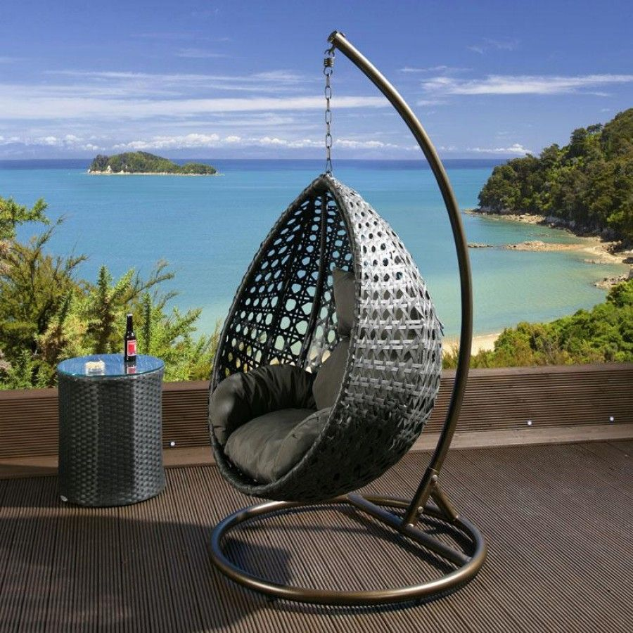 Black Rattan Hanging Chair With Grey Cushion Covers.