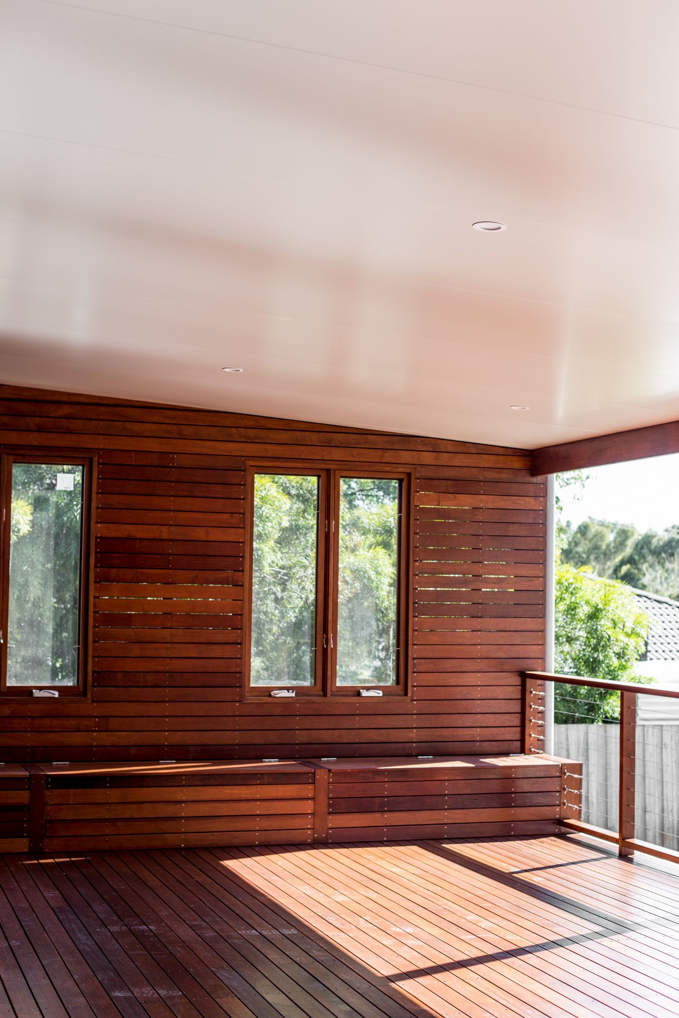 Deck Extension In Melbourne Featuring Merbau Screening, Deck And Storage