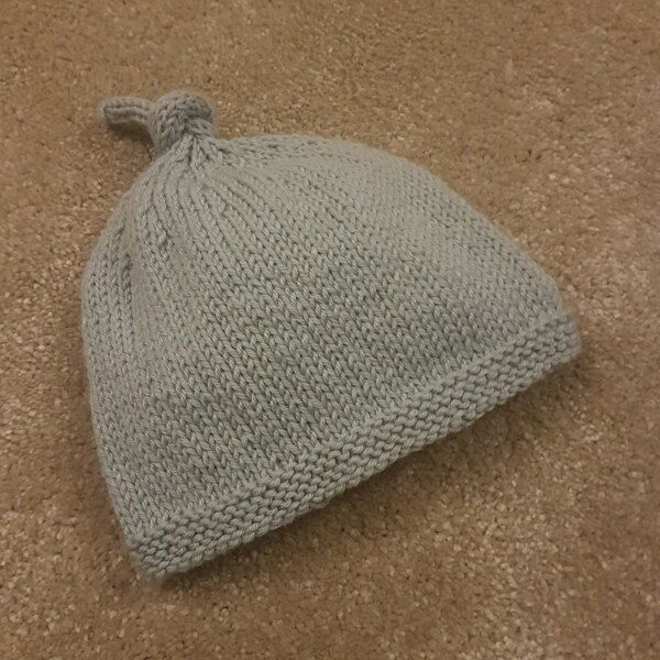 Tegan Baby Hat with Top Knot Knitting pattern by Julie Taylor afdbcb36541