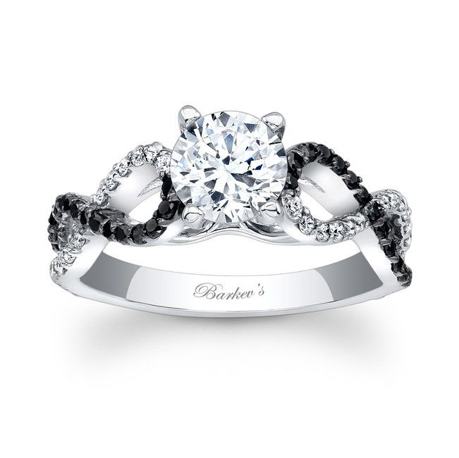 This diamond engagement ring has artfully curving cathedral shoulders  crisscross down the shank adorned with shared prong set black and white  diamonds for a ...