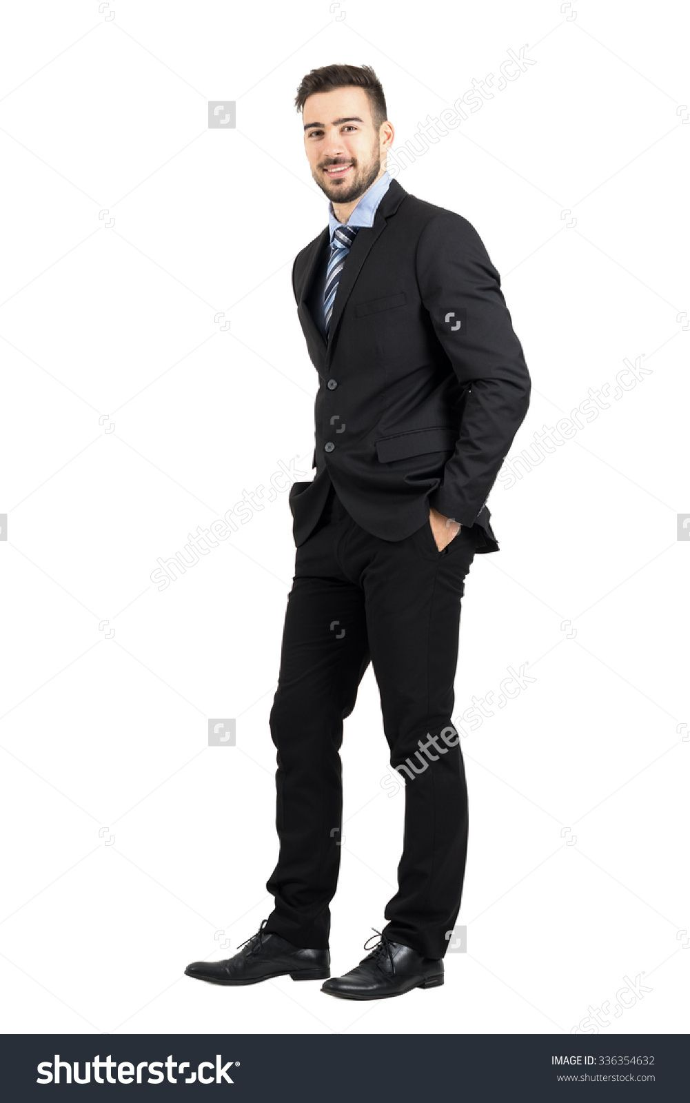 75ae4f2ff12 Confident happy business man with hands in pocket side view. Full body  length portrait isolated over white studio background.