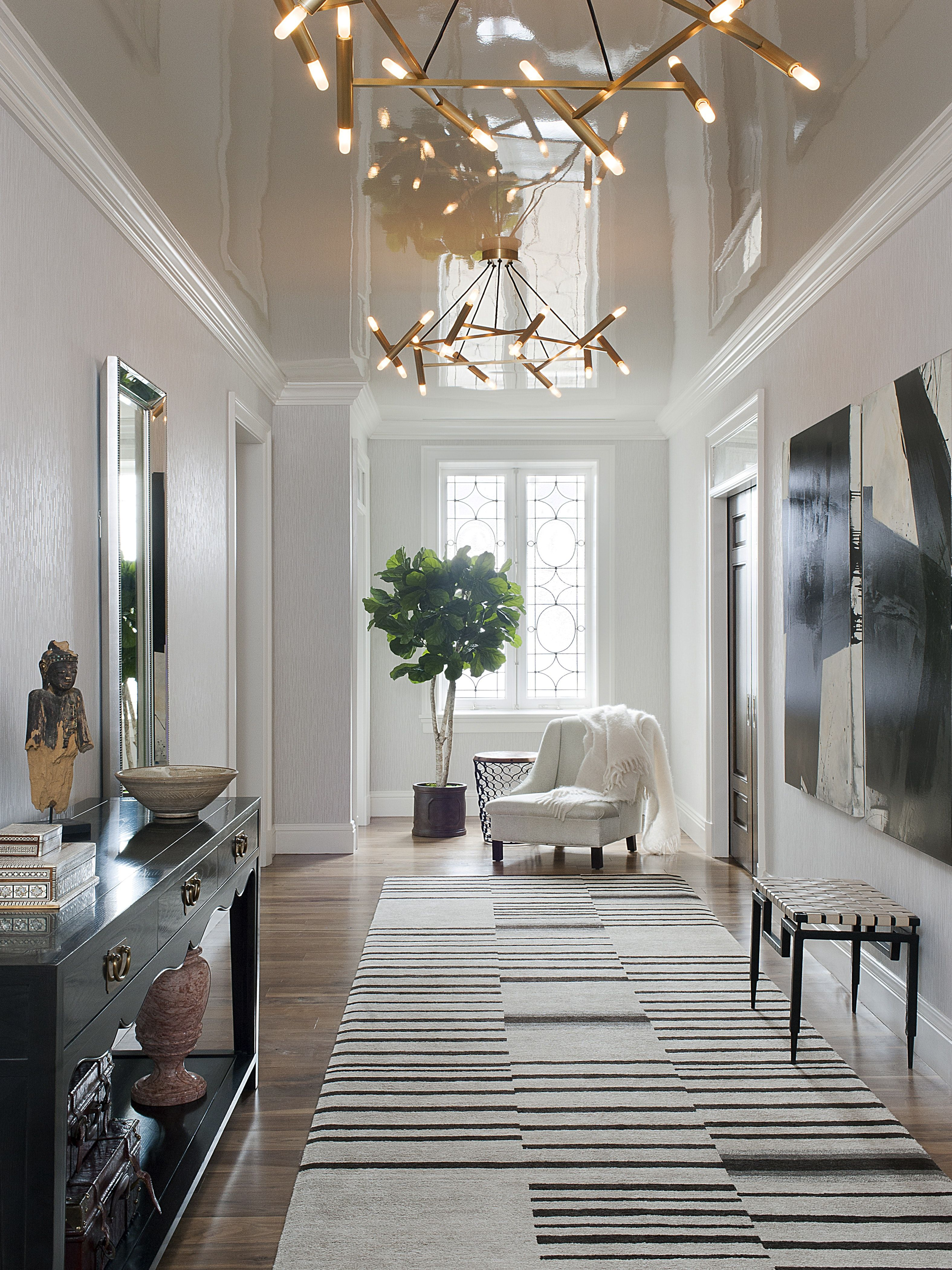 A High Gloss Lacquered Ceiling Reflects The Dramatic Entry Gallery