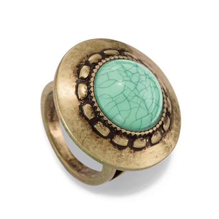 "The look of marbled stone takes the stage in this burnished brass round ring with a turquoise colored round stone approx. 1/2"" in diameter. Imported."