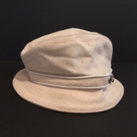 6d8338d983a4f Coach wool bucket hat with silver detailing. M L. This authentic Coach  bucket hat looks cute with leather jackets