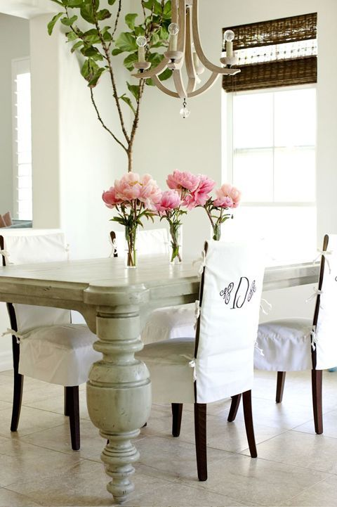 White Chunky Table Brown Chairs With Monogrammed Slipcovers Flowers Window Coverings Dining TablesDining RoomsDining