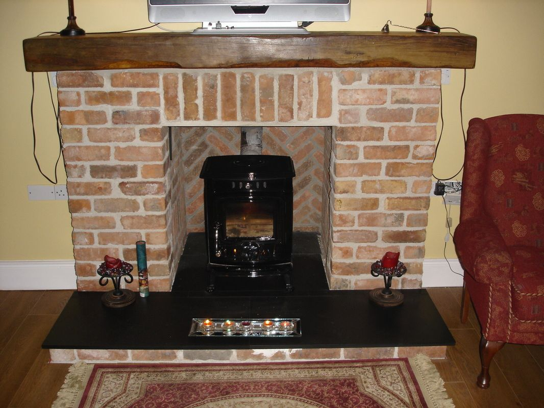Fireplace: Brick Fireplace In A Very Nice House To Warm The Room Seen From  The