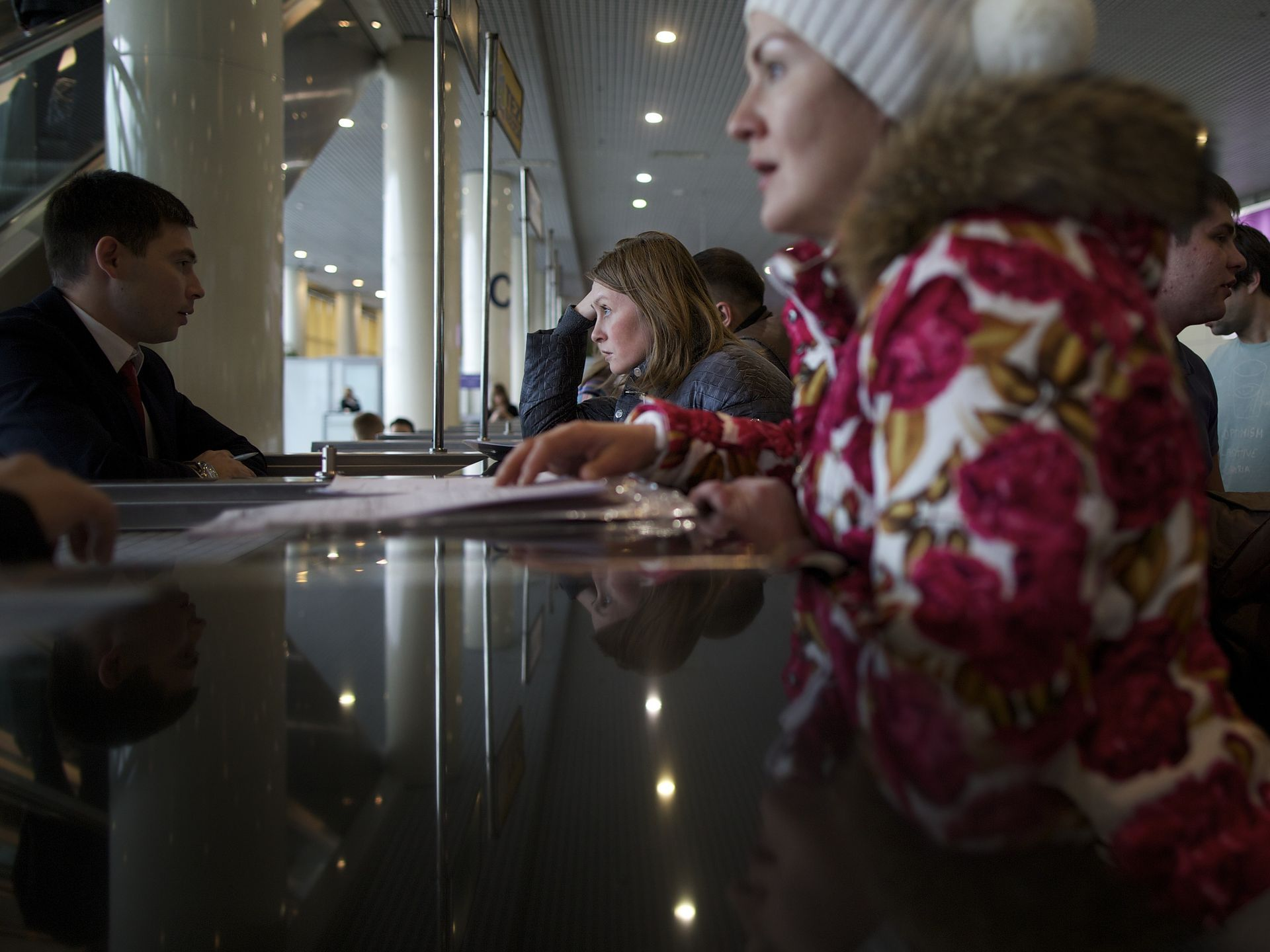 Stranded tourists line up at a travel agency desk in Domodedovo Airport in Moscow as their flight to Egypt is cancelled. Russia has suspended all flights to Egypt until aviation security procedures improve.  Alexander Zemlianichenko, AP