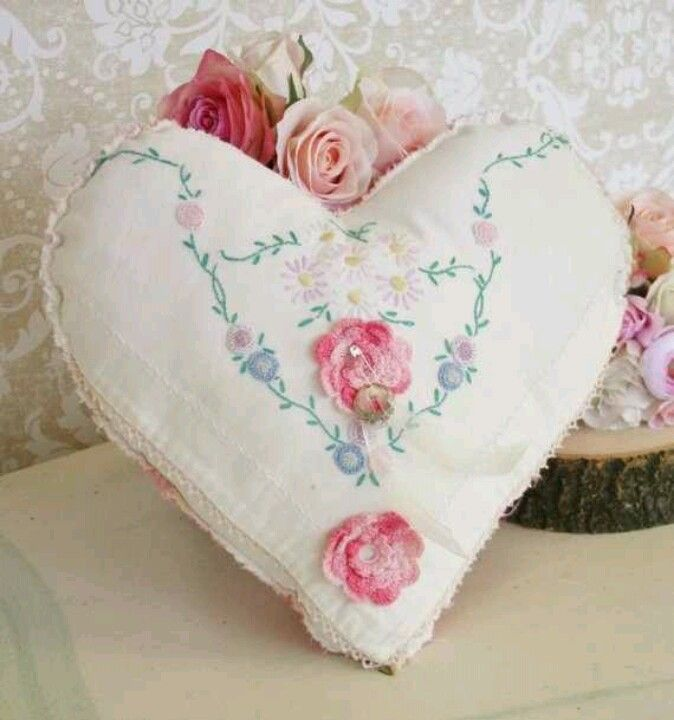 A lovely little heart with roses.  Appears to be made from a vintage embroidered linen.