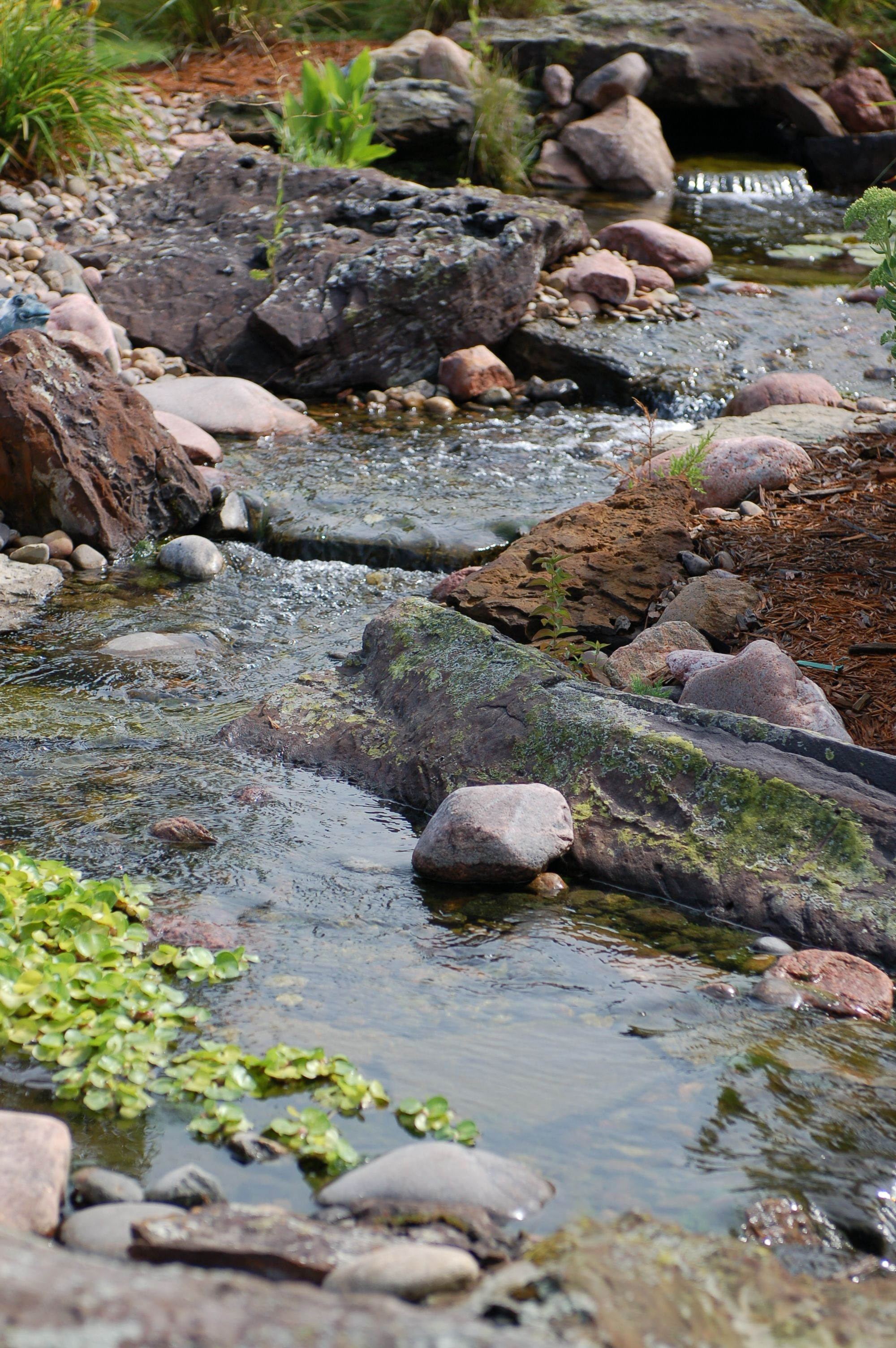 Stream water feature detail #TopekaLandscape