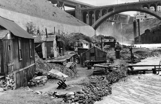 Shacktown, Spokane, 1945 | To the 20 men who live in the little cluster of shanties nestled on the bank of the Spokane River down under the Monroe St. Bridge, it represents one place in the community where man is supreme – there isn't a woman living in any of the houses. And it represents home, the spot where they can do exactly what they want to do, when they want to do it, and no one is there to tell them to stop. - C.R. Stark