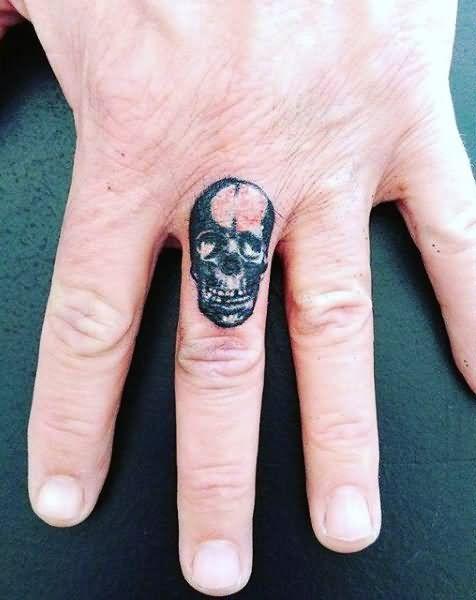 Black Ink Skull Tattoo On Finger Simple Finger Tattoo Finger Tattoos Tattoos For Guys