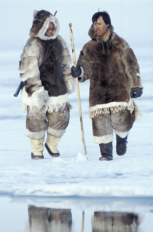 Inuit men in traditional dress on the ice in Nunavut ...
