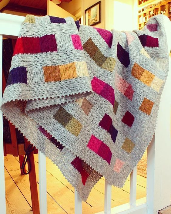 I love the style of this blanket and yes it\'s crocheted not knitted ...