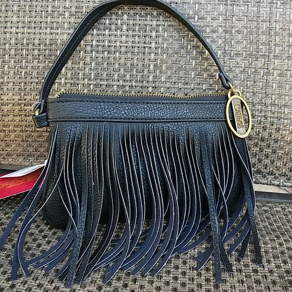 """Carlos Fringe Wristlet Black NWT Carlos by Carlos Santana Black Fringe Wristlet - So cute! Great for festival, Boho chic! Just the right size to take a the essentials with you and small enough (8.5""""x5.5"""") to throw in your regular handbag or crossbody! Zipper closure, Brass color hardware, inside zipper pocket too! Carlos Santana Bags Clutches & Wristlets"""