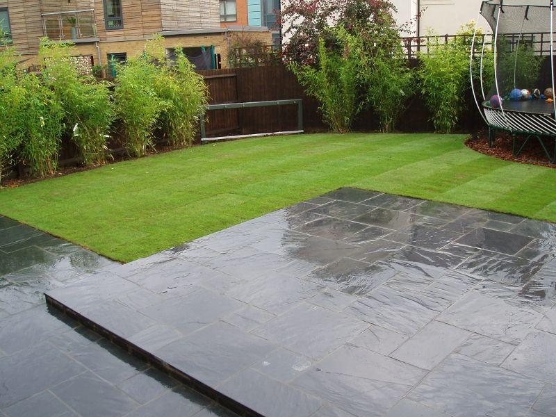 Porphyry black slate cobbles lawn porphyry black slate for Blue slate garden designs