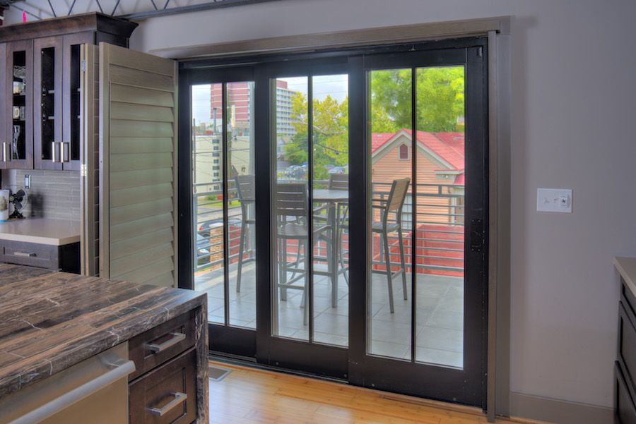 new products 77a1a 48335 Patio doors in the kitchen in this industrial loft are ...