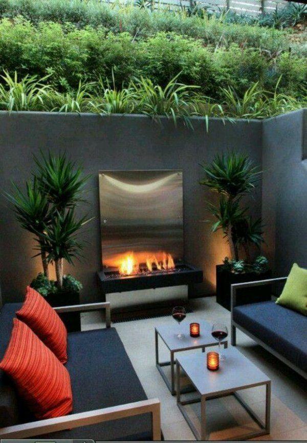 balkon designideen blechkamin sofa dekokissen steinmauer | outdoor ... - Outdoor Patio Design Ideen