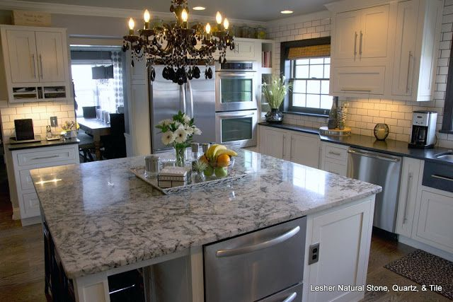 This kitchen with sex appeal has blue ice granite island for Kitchen counter sex