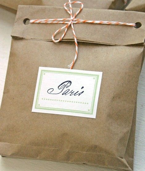 Use scraps and bits to dress up brown paper bags - many cute ideas here. You can make custom small bags from brown grocery ones by cutting them up and sewing two pieces together.