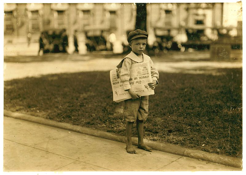 7 year old Ferris. newsie. Mobile, Alabama. Photograph by Lewis Wickes Hine, October 1914.