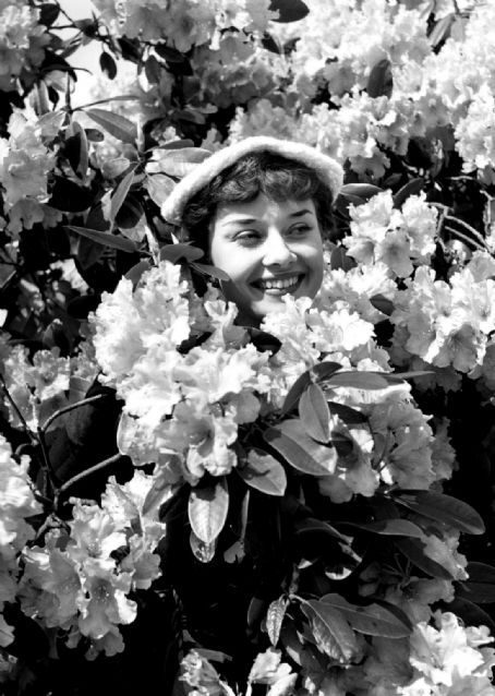 Audrey Hepburn. Gamines are often mischievous, and occasionally does unsophisticated things like hiding in bushes to surprise someone.