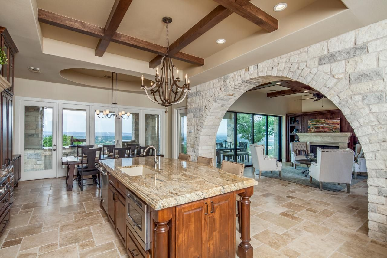 Mediterranean Style Kitchen Features Large Stone Archway