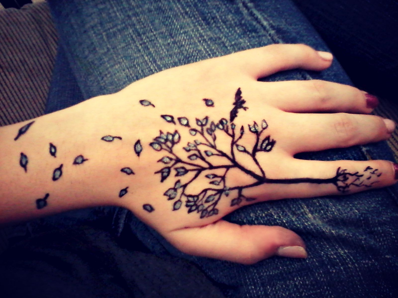 Hand tree tattoo with roots and escaping leaves. Hand