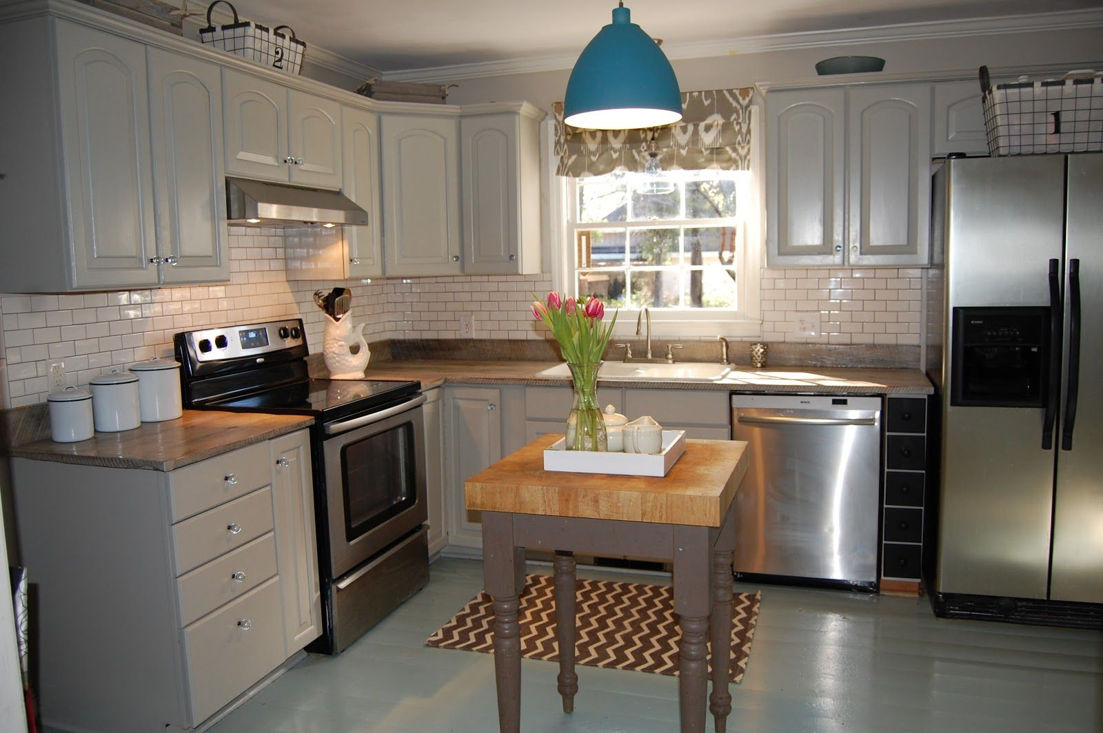Kitchen cabinets painted in a soft grey. | Grey kitchen ...