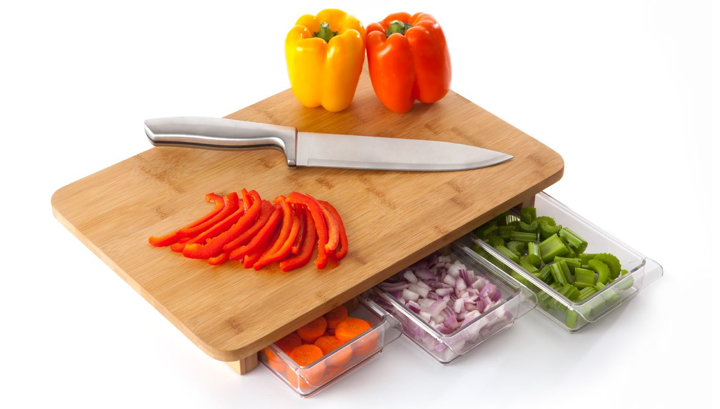 The Mocubo Modular Chopping Board with three separate under-board storage containers for quick and organized chopping. This is brilliant, and I'll be glad not to step on the droped little onion bits in the kitchen anymore.