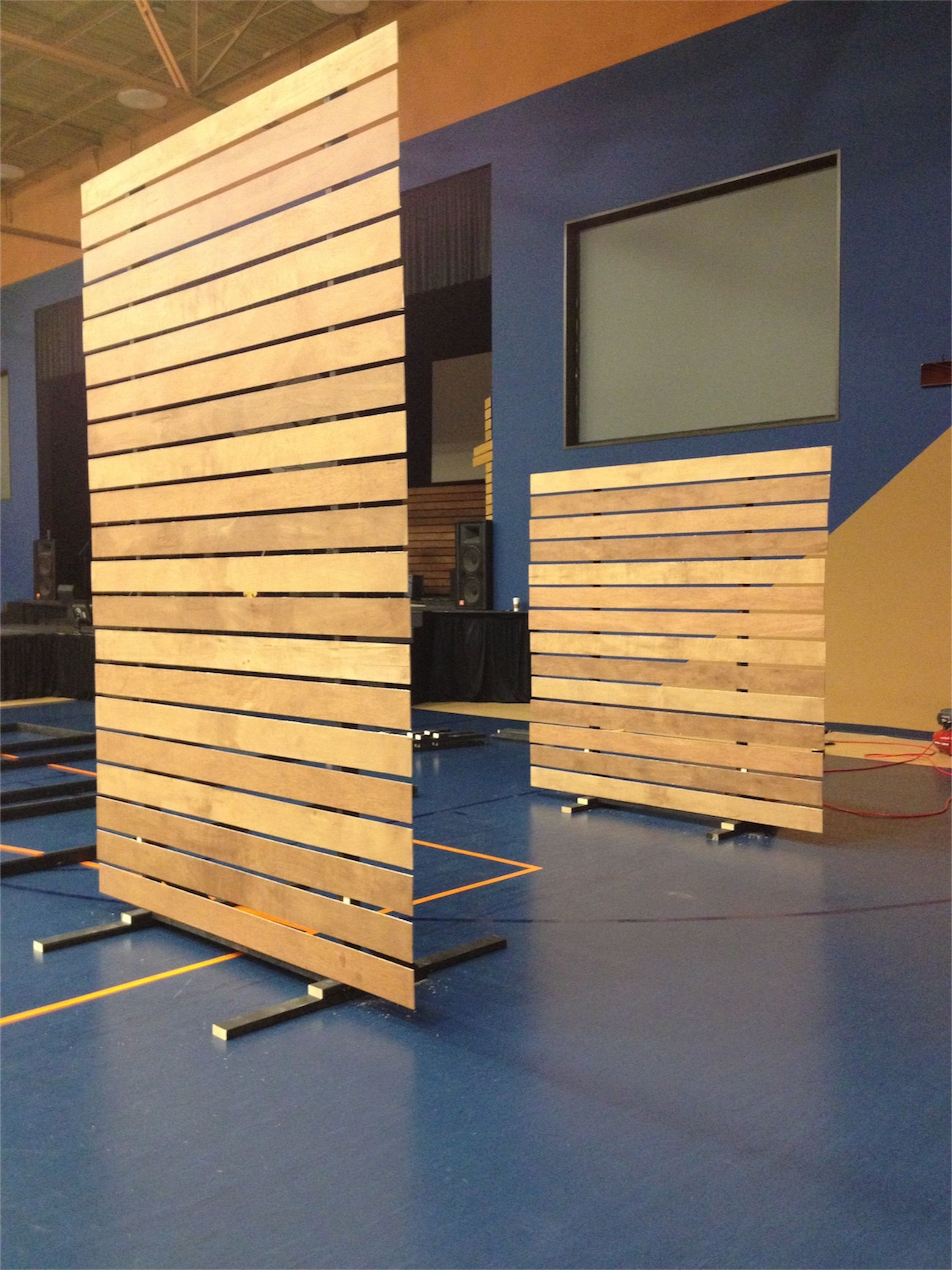 create a moveable partition wall on rollers for functional ...