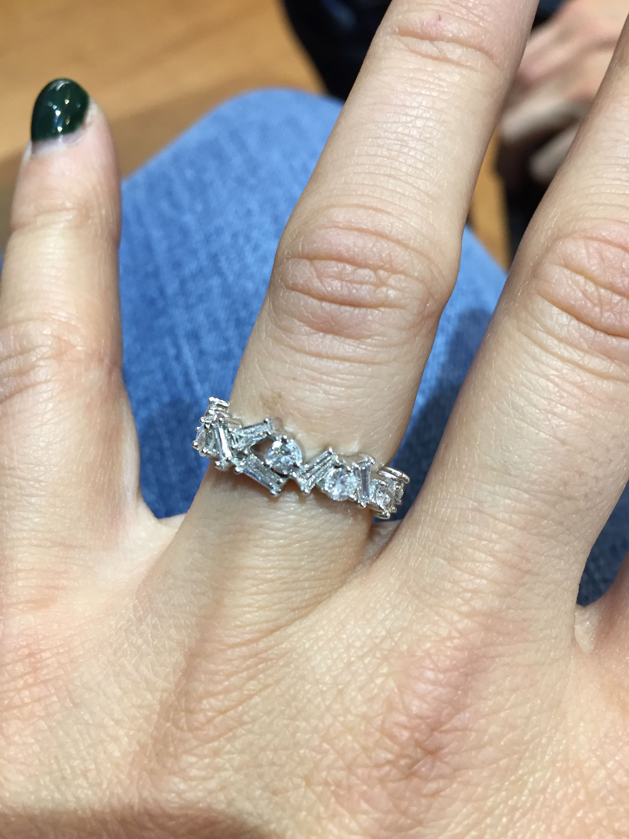 Abstract white gold band made with diamond baguettes and