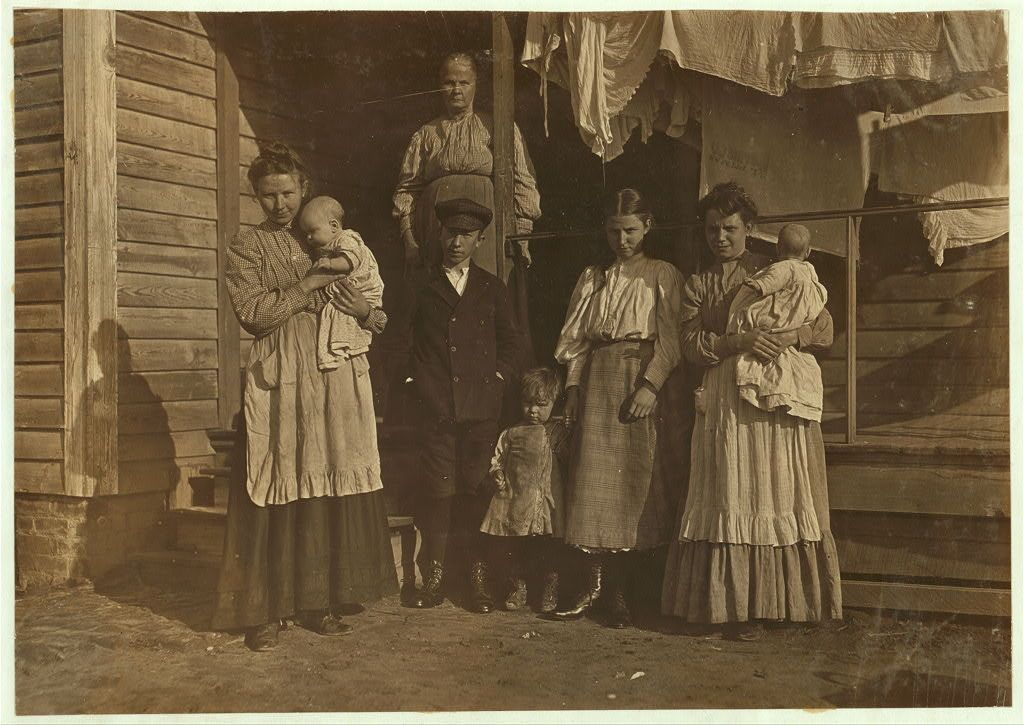 Maple Mill, Dillon, South Carolina by Lewis Hine. the three older children hae been working 3 years. the oldest girl runs 6 sides for .60 a day. the younger need to groe just a bit more and they will join ranks. 1908