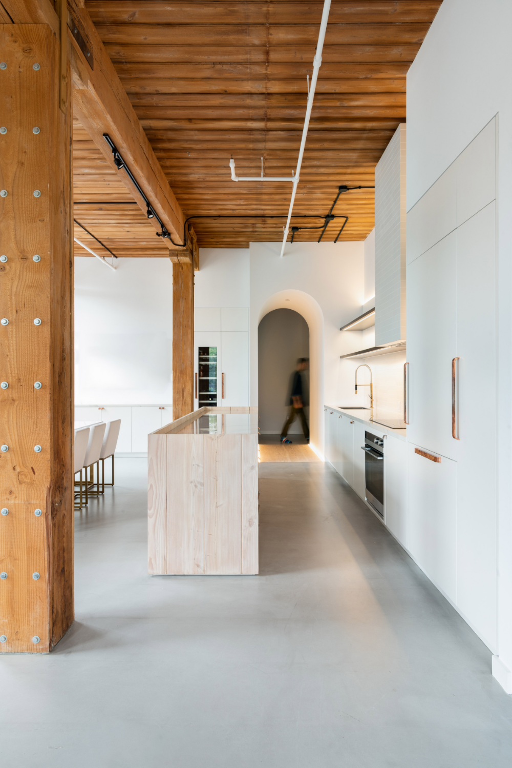StudioAC links Candy Loft interiors with arched hallways