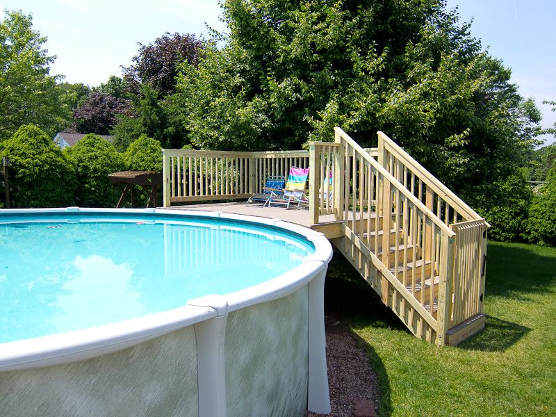 Decks and patios around above ground pool pictures for Wood pool deck design